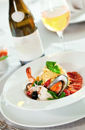 light meal: Seafood Spaghetti with Tiger Prawns, Scallops, Mussels, Calamari, Salmon and Tomato Sauce