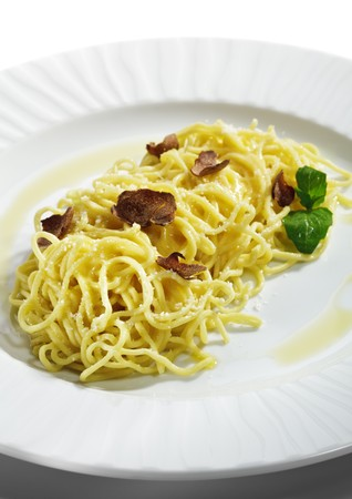 white truffle: Home made Pasta with Parmesan Cheese and Tartufo Bianco (white truffle). Served with Basil Leaf Stock Photo