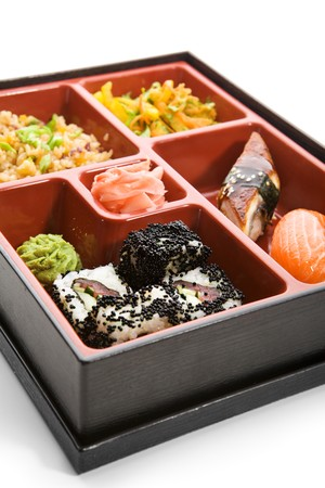 Japanese Bento Lunch - Salad with Hot Rice Appetizer and Sushi photo