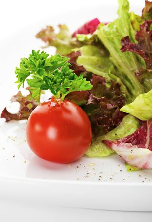 Cherry Tomato with Fresh Green Parsley and Salad Leaves photo