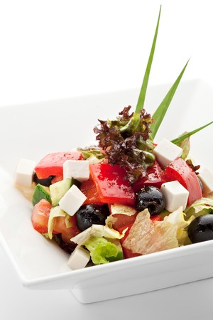 Greek Salad with Tomatoes, Cubed Feta Cheese, Olives, Cucumber and other Vegetables photo