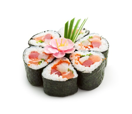 Seafood Maki Sushi - Roll made of Tuna,  Salmon, Scallop and Tobiko (flying fish roe) inside. Garnished with Pink Flower and Spring Onions photo