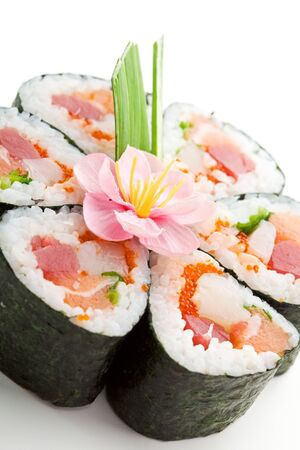 spring roll: Seafood Maki Sushi - Roll made of Tuna,  Salmon, Scallop and Tobiko (flying fish roe) inside. Garnished with Pink Flower and Spring Onions