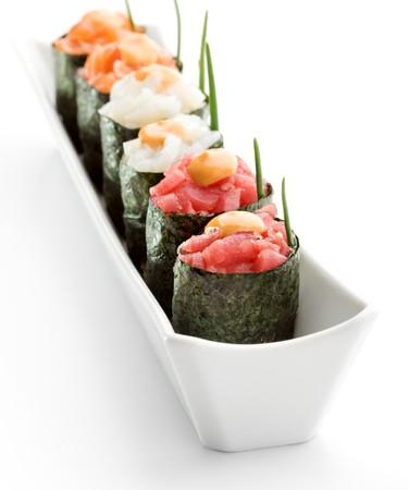 sake: Spicy Gunkan Sushi (salmon, tuna and scallop) with Sauce and Lettuce Stock Photo