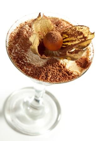 Tiramisu Dessert in a Glass Isolated over White photo