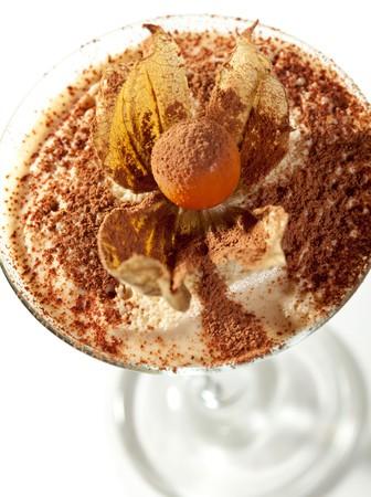 Tiramisu Dessert in a Glass. Isolated over White photo