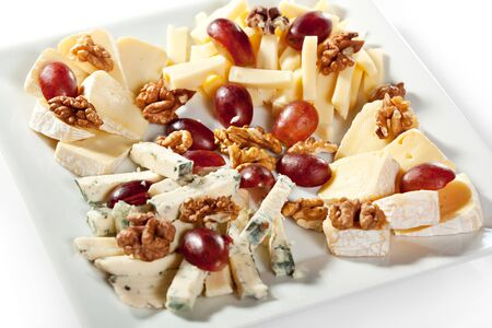Cheese Plate with Grapes and Sweet Sauce photo