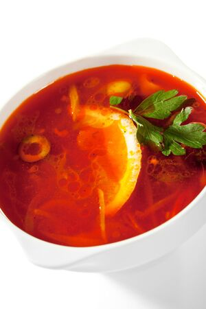 Soup - Solyanka. Dish of Stewed Cabbage and Meat with Spices and Lemon photo