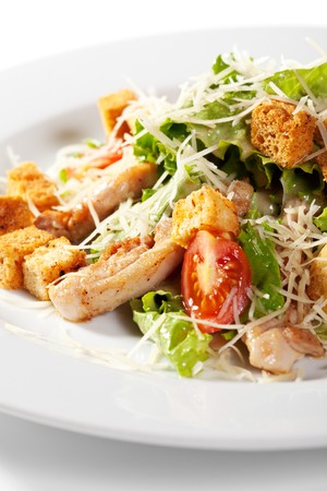 Caesar Salad with Meat. Comprises Romaine Salad Leaf and Croutons Dressed with Parmesan Cheese photo