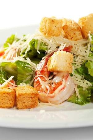 Caesar Salad with Seafood. Comprises Romaine Salad Leaf and Croutons Dressed with Parmesan Cheese photo