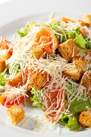 Caesar Salad with Salmon. Comprises Romaine Salad Leaf and Croutons Dressed with Parmesan Cheese photo