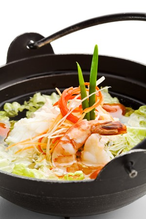 Soup with Seafoods and Chicken, Vegetables and Salad Leaf. Garnished with Lettuce photo