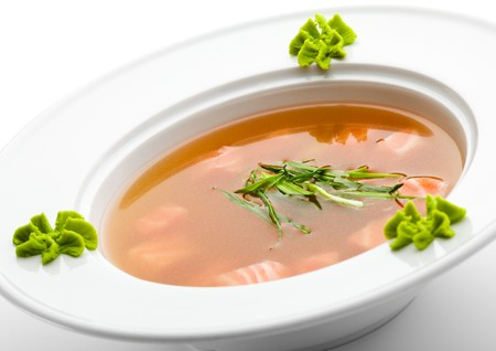 wasabi: Rice Soup with Salmon. Garnished with Leek and Wasabi Stock Photo