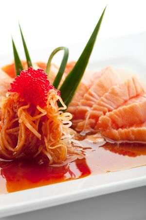 Japanese Cuisine - Salmon Fillet with Noodles and Sauce photo