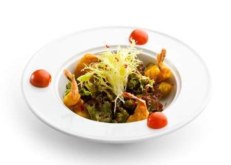 Salad with Deep Fried Shrimps and Herbs and Sauce. Garnished with Cherry Tomato photo