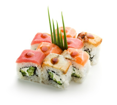 sake maki: Rainbow Maki Sushi - Roll with Cucumber and Cream Cheese inside. Tuna, Salmon and Eel outside Stock Photo