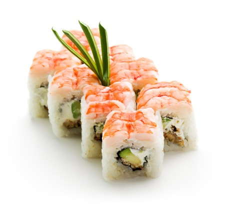 oriental cuisine: Japanese Cuisine - Sushi Roll with Avocado, Cream Cheese and Smoked Eel inside. Topped with Shrimp Stock Photo