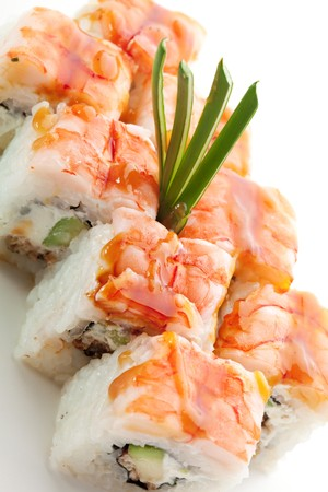 Japanese Cuisine - Sushi Roll with Avocado, Cream Cheese and Smoked Eel inside. Topped with Shrimp photo