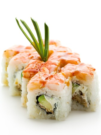 sushi roll: Japanese Cuisine - Sushi Roll with Avocado, Cream Cheese and Smoked Eel inside. Topped with Shrimp Stock Photo