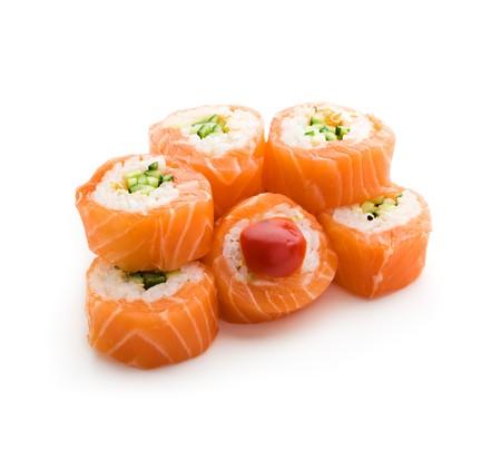 Maki Sushi - Roll made of Cucumber and Sesame inside. Fresh Salmon outside photo