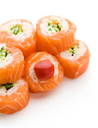 Maki Sushi - Roll made of Cucumber and Sesame inside. Fresh Salmon outside Stock Photo - 7772717