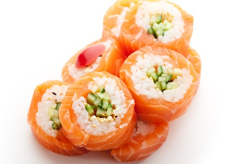 maki sushi: Maki Sushi - Roll made of Cucumber and Sesame inside. Fresh Salmon outside Banque d'images