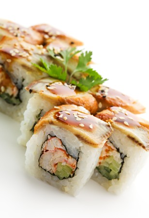 Maki Sushi with Crab Meat - Roll made of Crab Meat, Cucumber and Tobiko inside. Topped with Eel photo