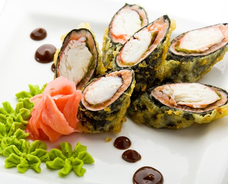 Tempura Maki Sushi - Deep Fried Roll made of Crab Meat, Salad Leaf and Unagi (eel) inside. Served with Sauce, Wasabi and Ginger photo