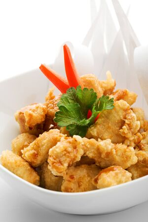 crispy: Japanese Cuisine - Tempura Chicken (Deep Fried Chicken) with Parsley. Garnished with Paper