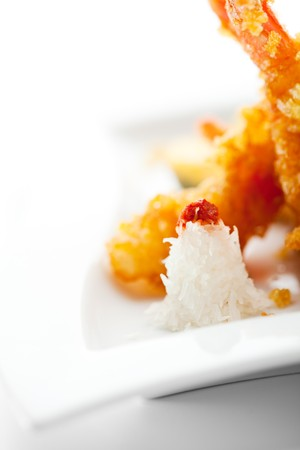 Daikon (White Radish) on Tempura Shrimps (Deep Fried Shrimps) Plate photo