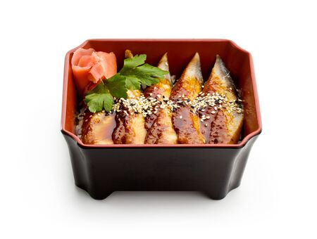 Japanese Cuisine - Unagi (Smoked Eel) on Rice with Sesame and Ginger photo
