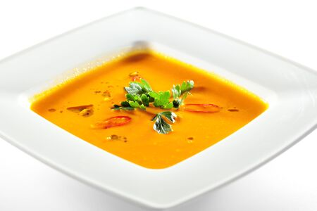 soup bowl: Bowl of Pumpkin Soup with Green Parsley Stock Photo