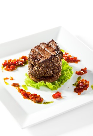 Beef Steak on Fresh Salad Leaf with Chili Sauce. Isolated on White Background Stock Photo - 7772759