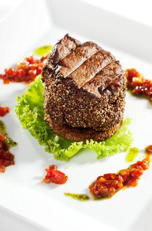 Beef Steak on Fresh Salad Leaf with Chili Sauce photo