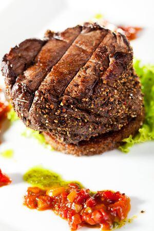 Beef Steak on Fresh Salad Leaf with Chili Sauce Stock Photo - 7773291