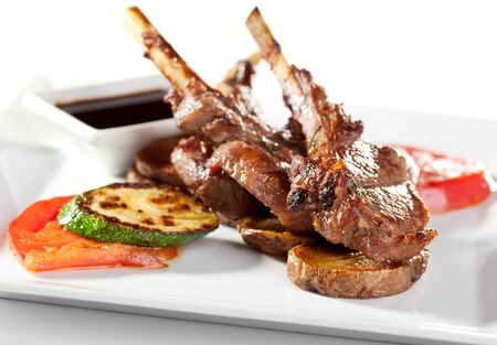lamb chop: Roasted Lamb Chops  with Tomato and Zucchini Garnished with Sauce