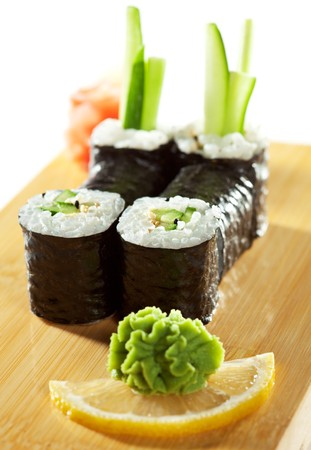 wasabi: Kappamaki - Cucumber Sushi Roll Garnished with Lemon and Wasabi on the Wooden Plate