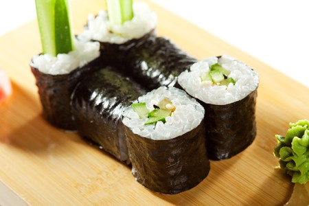 Kappamaki - Cucumber Sushi Roll Garnished with Lemon and Wasabi on the Wooden Plate photo