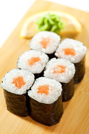 Sake Maki Sushi - Roll with Fresh Salmon. Served on the Wooden Plate Stock Photo - 7772931
