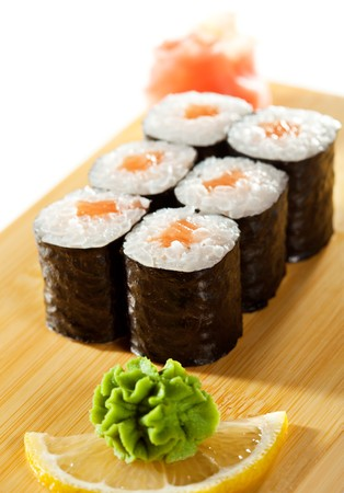 Sake Maki Sushi - Roll with Fresh Salmon. Served on the Wooden Plate Stock Photo - 7772765