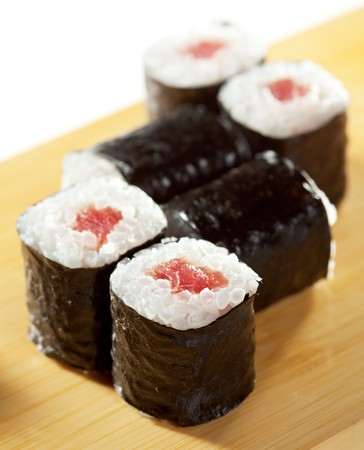 Maguro Maki Sushi - Roll with Fresh Tuna. Served on the Wooden Plate Stock Photo - 7772741