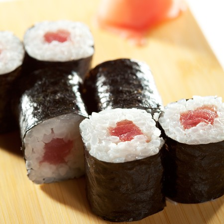 Maguro Maki Sushi - Roll with Fresh Tuna. Served on the Wooden Plate photo