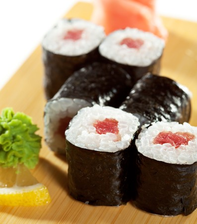 Maguro Maki Sushi - Roll with Fresh Tuna. Served on the Wooden Plate Stock Photo - 7772662