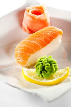 Japanese Cuisine -  Smoked Salmon (sake) Nigiri Sushi with Ginger and Wasabi photo