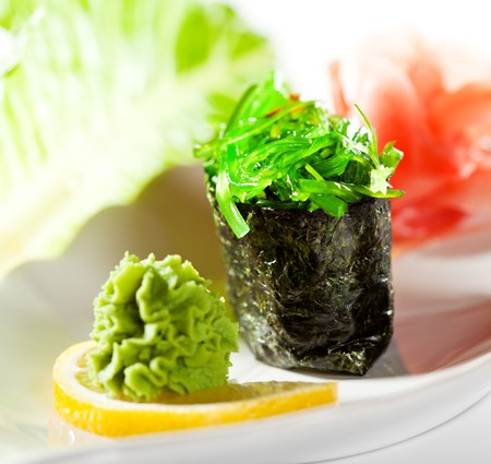 Chuka Seaweed  Gunkan Sushi Garnished with Lemon, Wasabi and Ginger Stock Photo