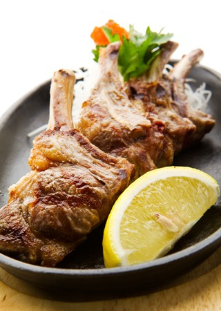lamb chop: Grilled Foods - Rack of Lamb with Parsley, White Radish and Lemon Slice Stock Photo