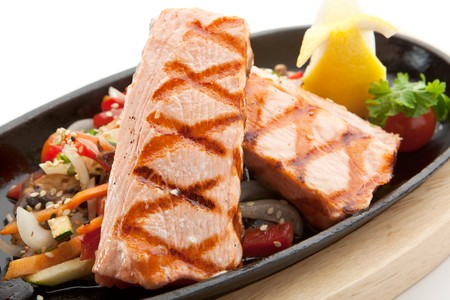 Grilled Foods - Salmon Steak with Vegetables. Garnished with Lemon and Parsley Stock Photo - 7773345