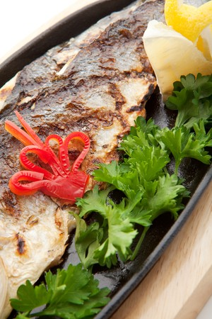 Grilled Foods - Grilled Fish with Lemon and Parsley photo