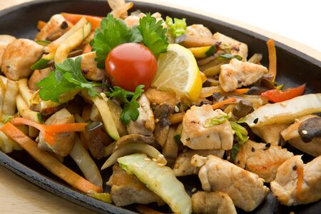 Grilled Foods - Fillet of Chicken with Vegetables. Garnished with Cherry Tomato, Lemon and Parsley photo