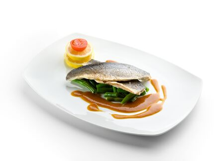 Steamed Fish with Sauce, Lemon and Cherry Tomato photo